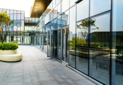 Modern glass office exterior which houses companies dealing with the property market