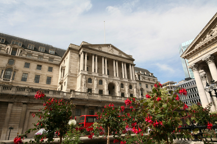 Exterior of the Bank of England. Economic review looks at faster rebound; slower recovery.
