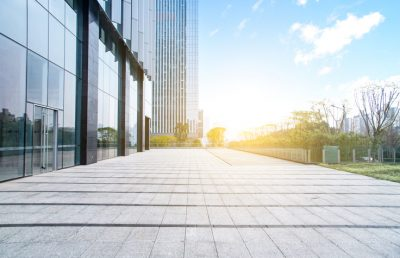 Exterior or modern office building, property transactions slow, but warehouse demand rises